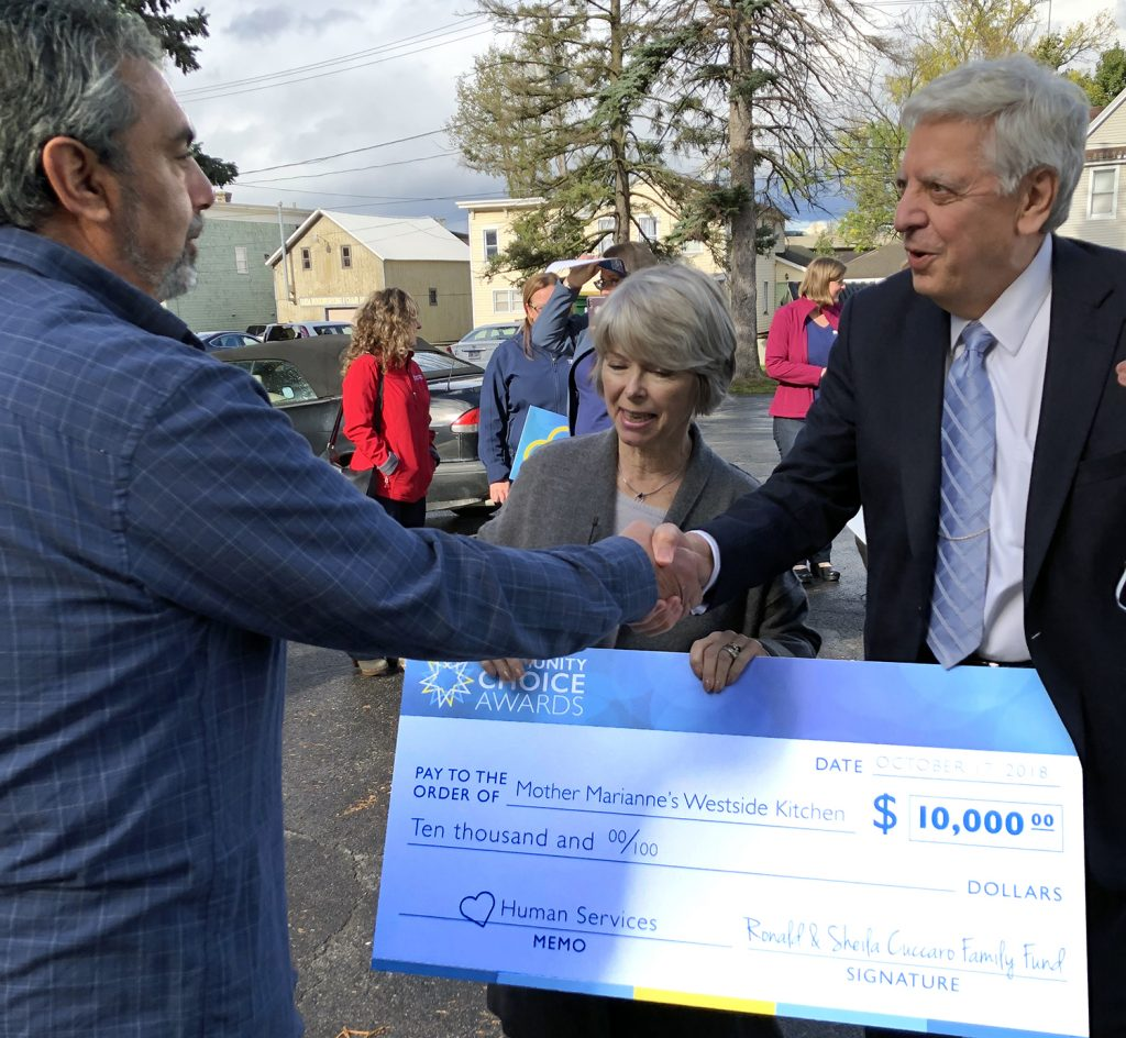 Ed Morgan receives $10,000 Community Choice Award from Ron & Sheila Cuccaro.