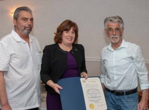Assemblywoman Marianne Buttenschon presents citation to Director Ed Morgan (left) and Advisory Board Chair John Sullivan.