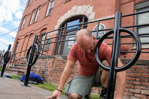Matt VanSlyke installs bike racks at Mother Marianne's West Side Kitchen.