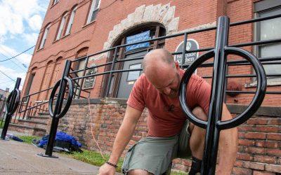 Matt VanSlyke installs bike racks at Mother Marianne's West Side Kitchen.
