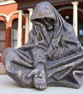 Sculpture of Christ as homeless man