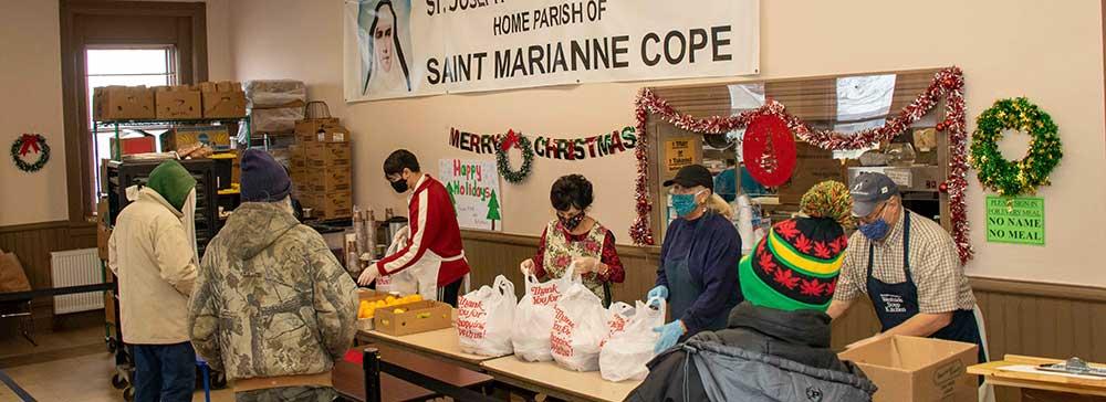 Volunteers serve meals